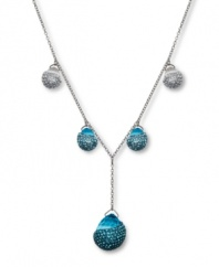 Dazzling and dramatic. Aquarmarine-hued crystals combine with clear crystal Pointiage® accents to enhance the beauty of Swarovski's Play Indicolite Y pendant necklace. Set in silver tone mixed metal. Approximate length: 15-7/10 inches. Approximate drop: 1-1/2 inches.