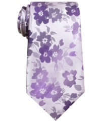 With a fresh floral pattern, this tie from John Ashford will easily grow on you.
