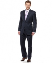 Keeps your wardrobe on the cutting edge with this slim-fit navy suit from Calvin Klein.
