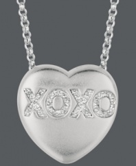 Say it from the heart. Sweethearts' adorable heart-shaped pendant expresses more that just great style with the letters XOXO written in round-cut diamonds (1/10 ct. t.w.) across the surface. Pendant crafted in sterling silver. Copyright © 2011 New England Confectionery Company. Approximate length: 16 inches + 2-inch extender. Approximate drop: 5/8 inch.
